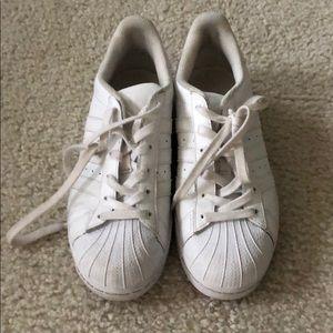 Men's white Adidas shell toe sneakers